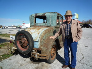 Dad by and old Model A like one he owned as a young man